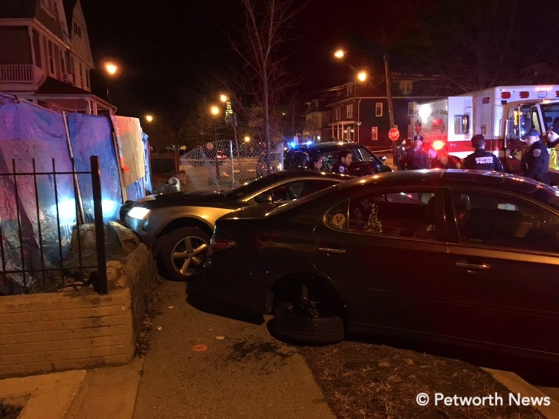 Two cars up on the sidewalk on the 800 block of Varnum. The darker, nearer vehicle, had been parked on the street.
