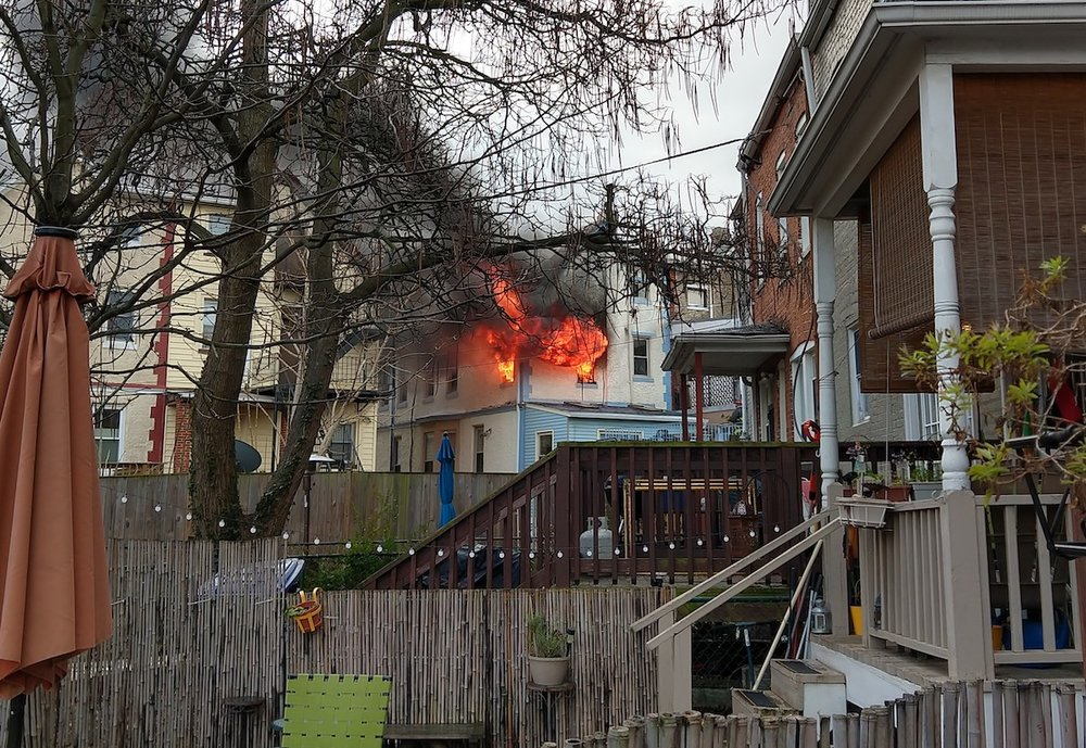 Fire blazes out of the top floor of a house on Randolph Street shortly before DC Fire arrived (photo: D. Astudillo)