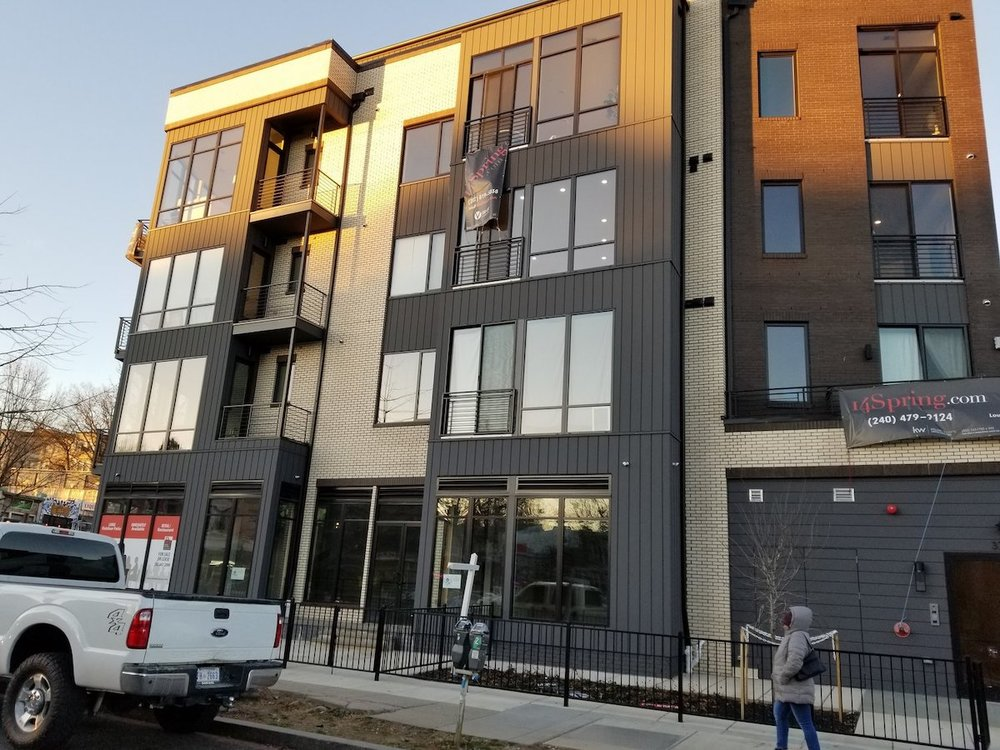 Developer ERB included a ground floor retail space in its 14Spring development at the request of the ANC. The space has been sitting empty since September, even as the condos above it have sold.