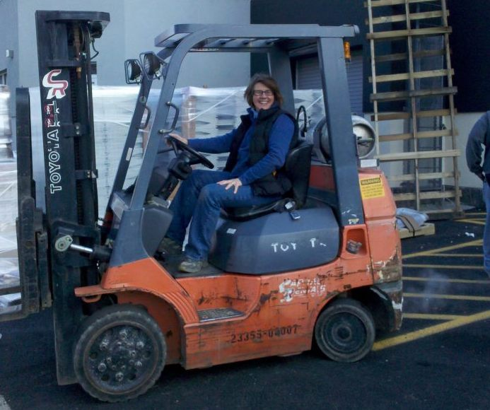 Anne running the forklift at the hardware store.