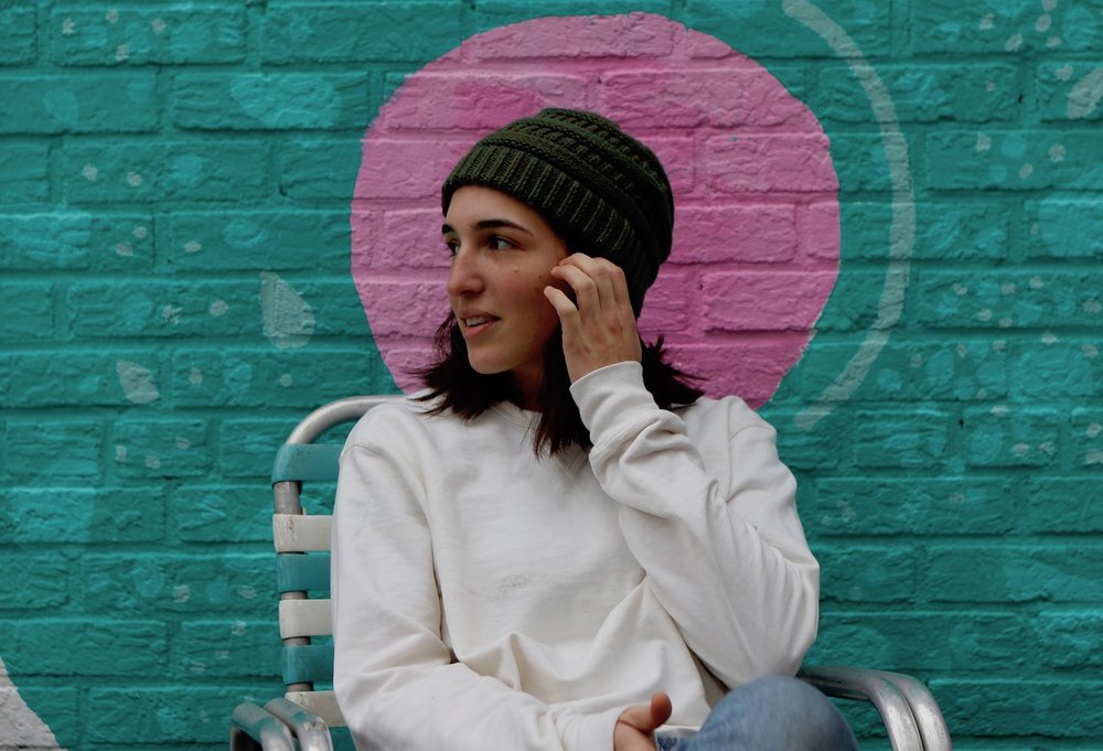 Dani Moreira sitting outside of Call Your Mother Deli in Park View