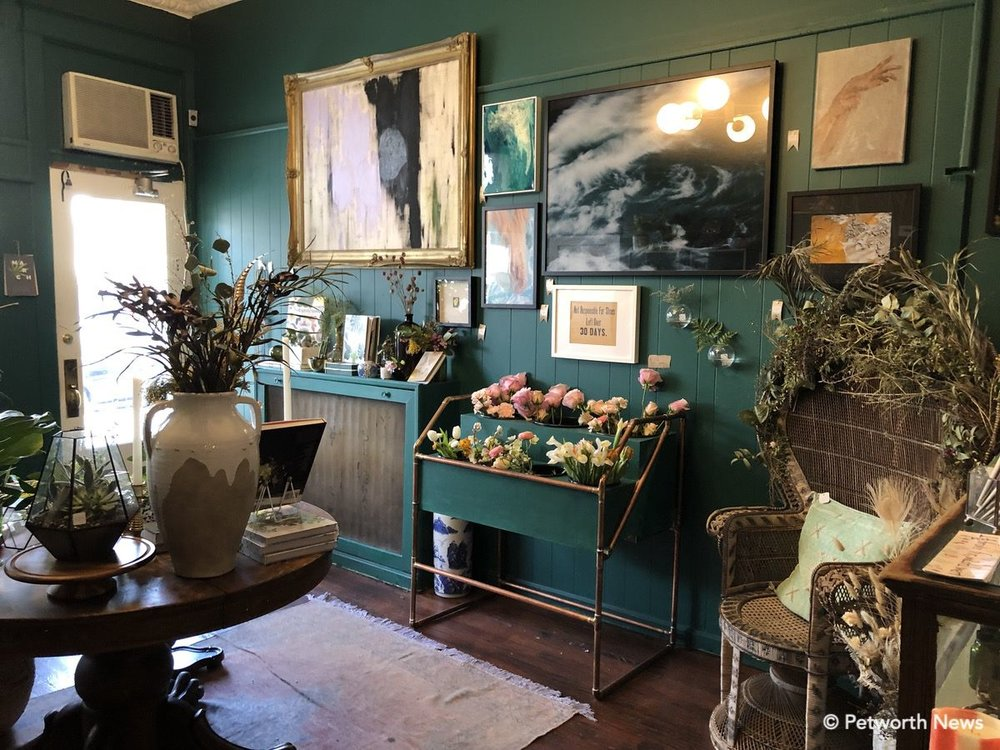 The interior of She Loves Me is filled with plants, art, jewelry and other amazing items.