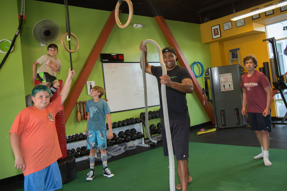 Quinn makes fitness seem like all fun and games in his class for youth at Rocky's Fitness Center in Capitola.