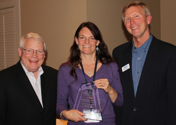 Shannon Junior of SOLitude Lake Management received her Applicator of the Year award from Bill Culpepper (left), President and CEO of SePRO Corporation and Sam Barrick, Executive Director of SePRO's Aquatics Business Unit, at the Preferred Applicator Seminar in Whitakers, North Carolina.