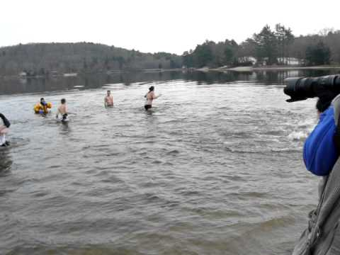 "Moosup pond during its annual ""Panther Plunge."" Credit: i.ytimg.com"