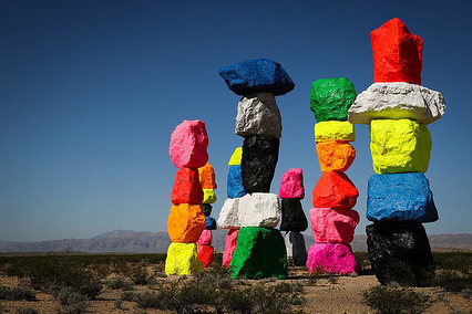 "Ugo Rondinone, Seven Magic Mountains Las Vegas, Nevada  Seven thirty to thirty-five-foot high dayglow totems comprised of painted, locally-sourced boulders.  Visible across the desert landscape along Interstate 15, Seven Magic Mountains offers a creative critique of the simulacra of destinations like Las Vegas. According to Rondinone, the location is physically and symbolically mid-way between the natural and the artificial: the natural is expressed by the mountain ranges, desert, and Jean Dry Lake backdrop, and the artificial is expressed by the highway and the constant flow of traffic between Los Angeles and Las Vegas. Seven Magic Mountains is produced by the Art Production Fund, New York and Nevada Museum of Art, Reno. Approximately 10 miles south of the intersection of Las Vegas Boulevard and St. Rose Parkway in Henderson, the installation site is a short distance from Jean Dry Lake where Michael Heizer and Jean Tinquely created legendary land art works in the 1960s.  Ugo Rondinone, born 1964 in Brunnen, Switzerland, lives and works in New York and has long embraced a fluid range of forms and media. By allowing himself such formal, Rondinone creates the conditions for an expansive emotional range. His work has become recognized for its ability to channel both psychological expressiveness and profound insight in the human condition and the relationship between human being and nature. Referring concurrently to the natural world, romanticism and existentialism, his works encapsulate a ""mental trinity"" that has underpinned his art for more than twenty years.  Text and image source: http://sevenmagicmountains.com/about/  Additional photographs sourced:  Las Vegas Review Journal artsy.net cloudfront.net #greatpublicart #sevenmagicmountains #ugorondinone #totem #contemporaryart #publicart #desert #desertart #artproductionfund #newyorkmuseumofmodernart #nevadamusuemofart #lasvegas"