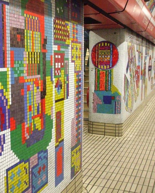 Eduardo Paolozzi, Tottenham Court Road Mosaics (1984) London Underground U.K.  In 1979, the year of Margaret Thatcher's first election victory, a member of the Tube's team saw a mural the Scottish pop artist Eduardo Paolozzi had made for a residential building in West Berlin, and recommended he be asked to redecorate Tottenham Court Road station. Paolozzi responded with a series of mosaics that covered platform walls, access corridors and a former lift shaft that linked the Central and Northern lines to the ticket office above. He drew on motifs familiar from his earlier work: vast, colourful cogwheels, butterflies, slabs of abstract electronics, voodoo masks and heroic comic-book figures. He also included other reminders of life above ground: saxophones and cameras, fast food, and artefacts from the British Museum. Paolozzi had originally intended his murals to cover the tunnel walls opposite the platforms and, although London Transport decided it could not lose that captive source of advertising revenue, his work remained, from the time it was unveiled in 1984, blessedly ad-free.  Eduardo Paolozzi was one of Britain's most influential post-war artists. His varied work, both complex and sometimes playful, defied artistic categories. He was chosen to exhibit in the British Pavilion at the Venice Biennial no less than five times, and displayed his artworks regularly in international exhibitions. His many accolades included a Knighthood, which he received in 1989, following his appointment as Her Majesty's Sculptor in Ordinary for Scotland.  Text excerpt Frieze article Public Property by Brian Dillon https://frieze.com/article/public-property  Image source: tfl.gov.uk  http://www.drostle.com/recreating-paolozzis-great-mosaics-for-tottenham-court-road/  #eduardopaolozzi #tottenhamcourtroad #postwarart #greatpublicart #contemporaryart #motif #frieze
