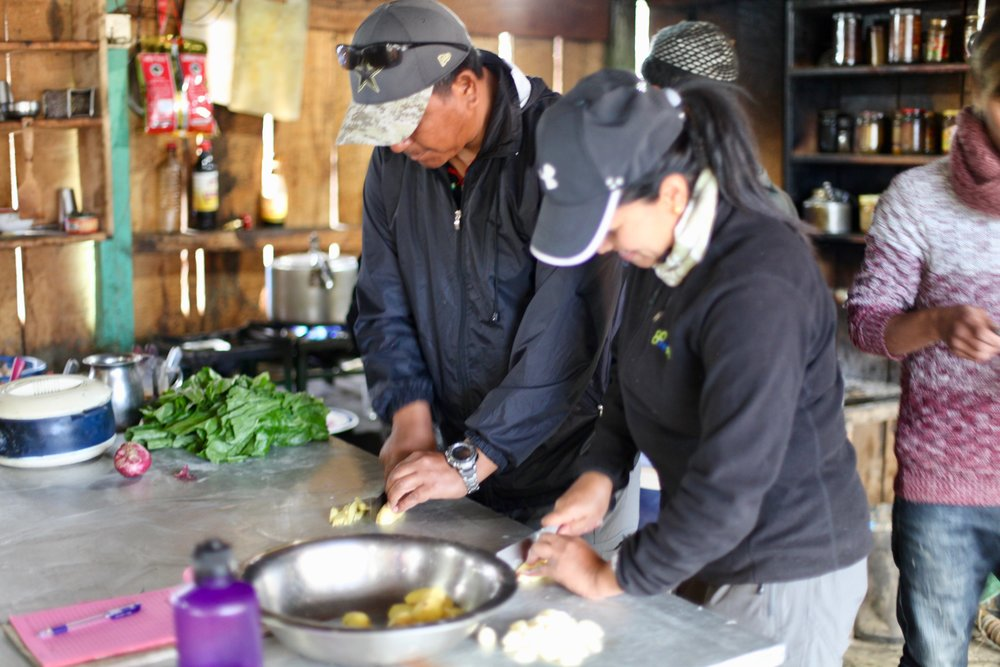 OneSeed guides Lalkaji, Kale, and Bishnu helped make some delicious food on a OneSeed staff trip earlier this year!