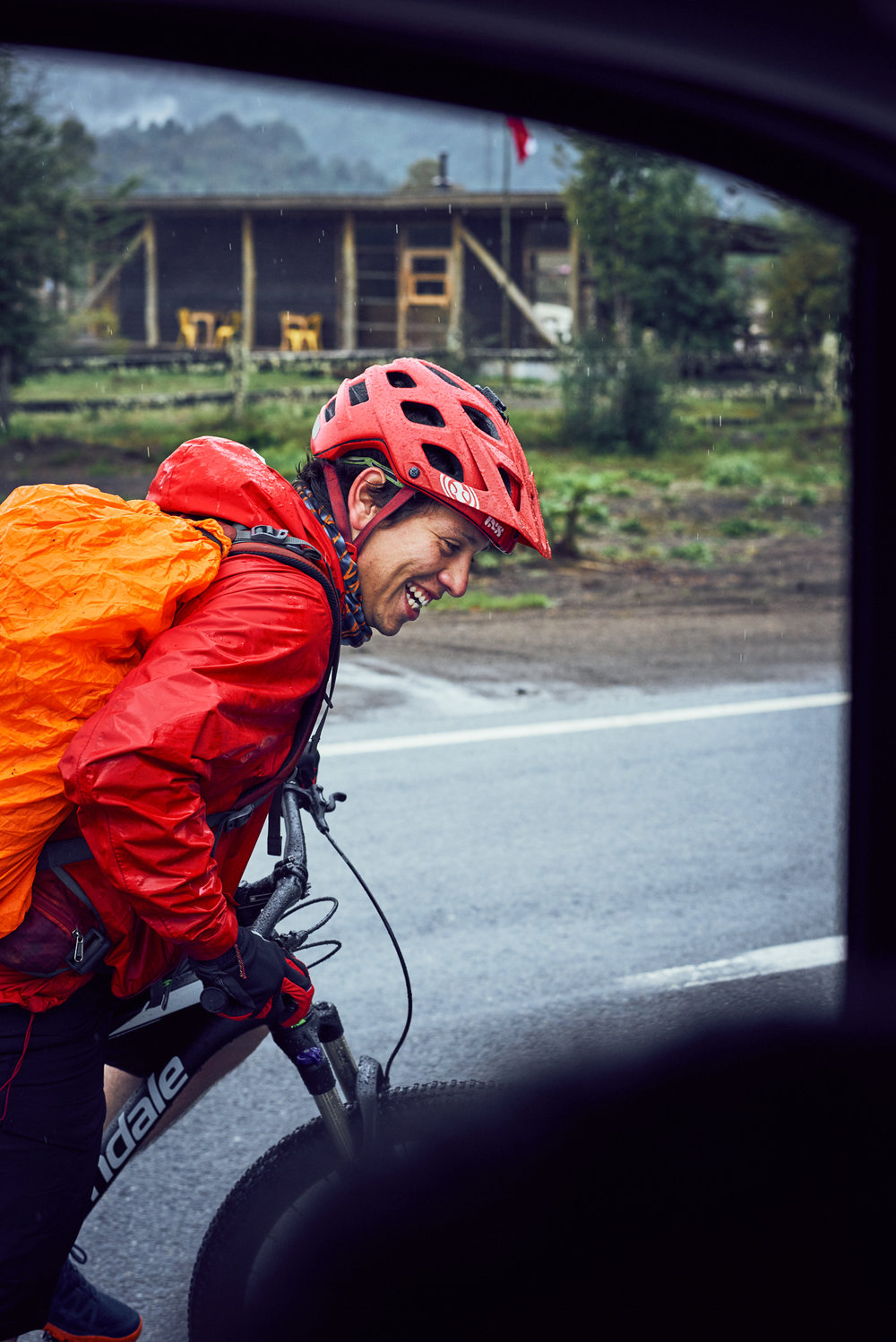Franco Riding in Rain Near Hornopiren.jpg