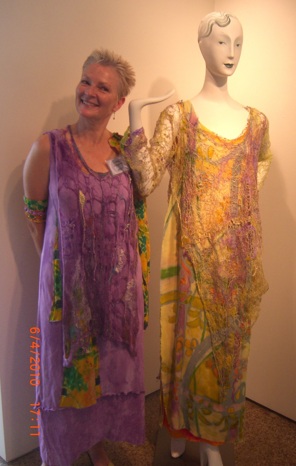 "This is me at my first juried show in 2010, 'Inside Out', with my piece ""Inner Journey Soul Image'. This exhibition featured works of art that covered the physical form, yet revealed the soul of the artist. These pieces were hand painted, hand felted, and machine embroidered."