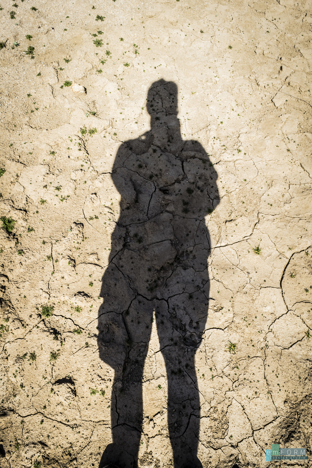 Cracked lake bed adds wonderful texture to my shadow.