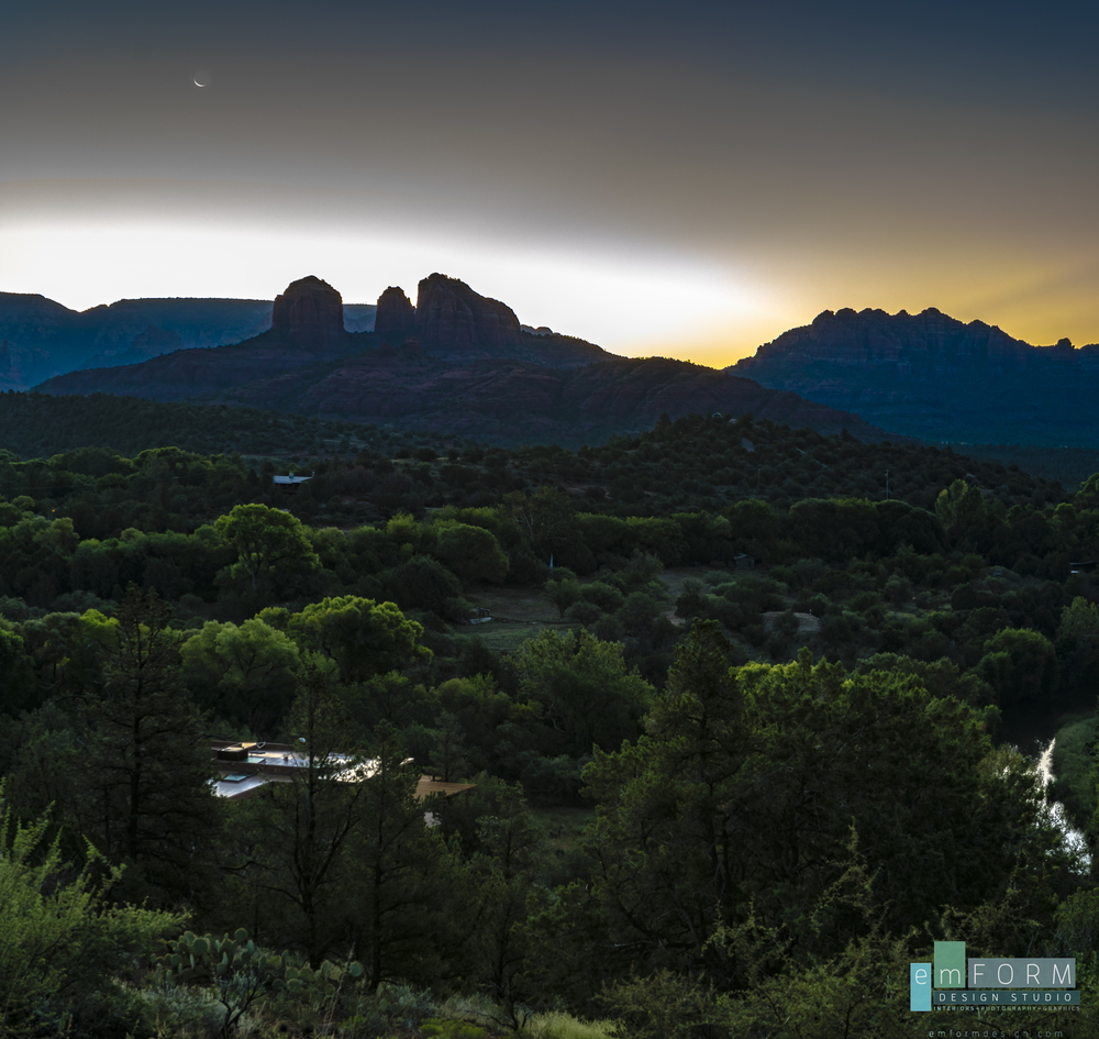 A tiny bit of the moon still shows as the sun comes up over Cathedral Rock.  The bottom left building is Sun Cliff Resort, the perfect place to experience the best sunrises in Sedona!
