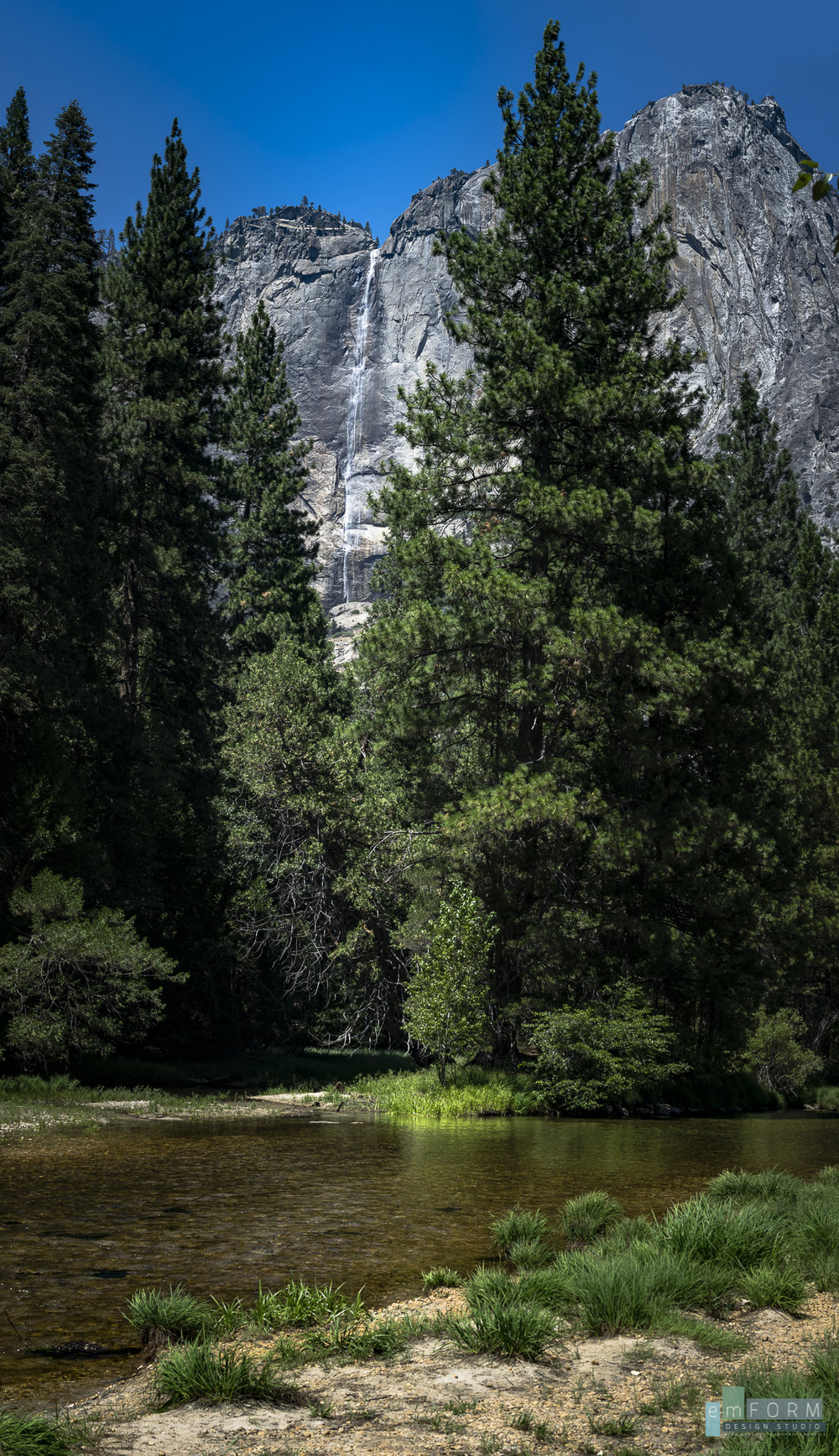 Yosemite Falls above the Merced River in Yosemite Valley, during a particularly hot day. We spent most of the day sitting in the river to keep cool while absorbing the magnificent views. Four shot vertical pano - 50mm - F9 - 1/320sec - ISO100
