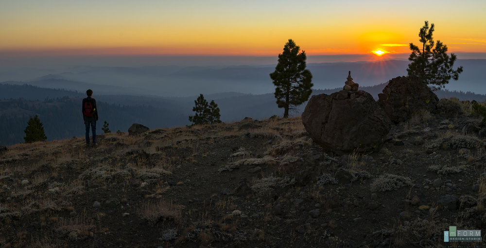 My son watches the sun set behind the distant mountains, which are surrounded by a mystical blanket of smoke. Two shot pano -ISO100 - F11 - 1/13sec - 24mm