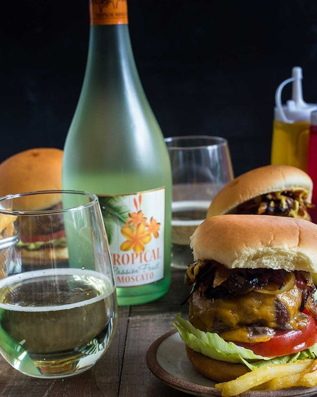 Are you grilling this weekend? We can't wait to enjoy Tropical Moscato with our yummy burgers!  #tropical #moscato #tropicalmoscato #passionfruit #paradiseinaglass #cheers #grilling #bbq #labordayweekend #weekendvibes #friyay #winetime #summerfun #delicious #foodandwine #winepairing