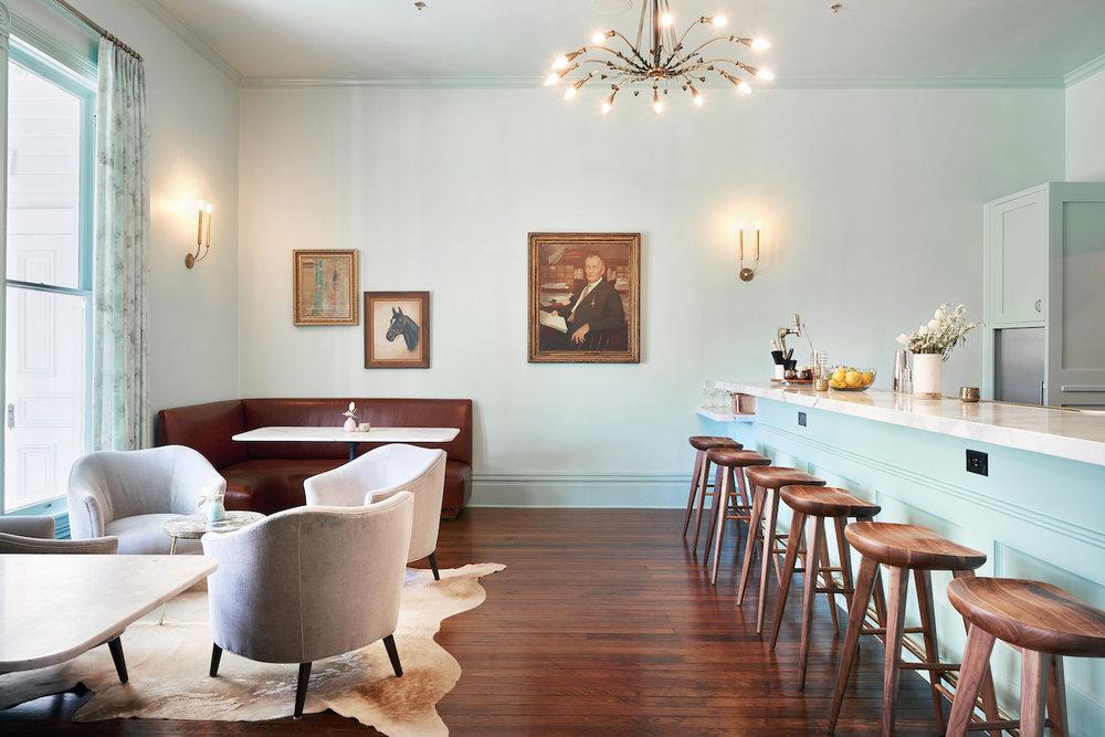 gray velvet chairs mint wall