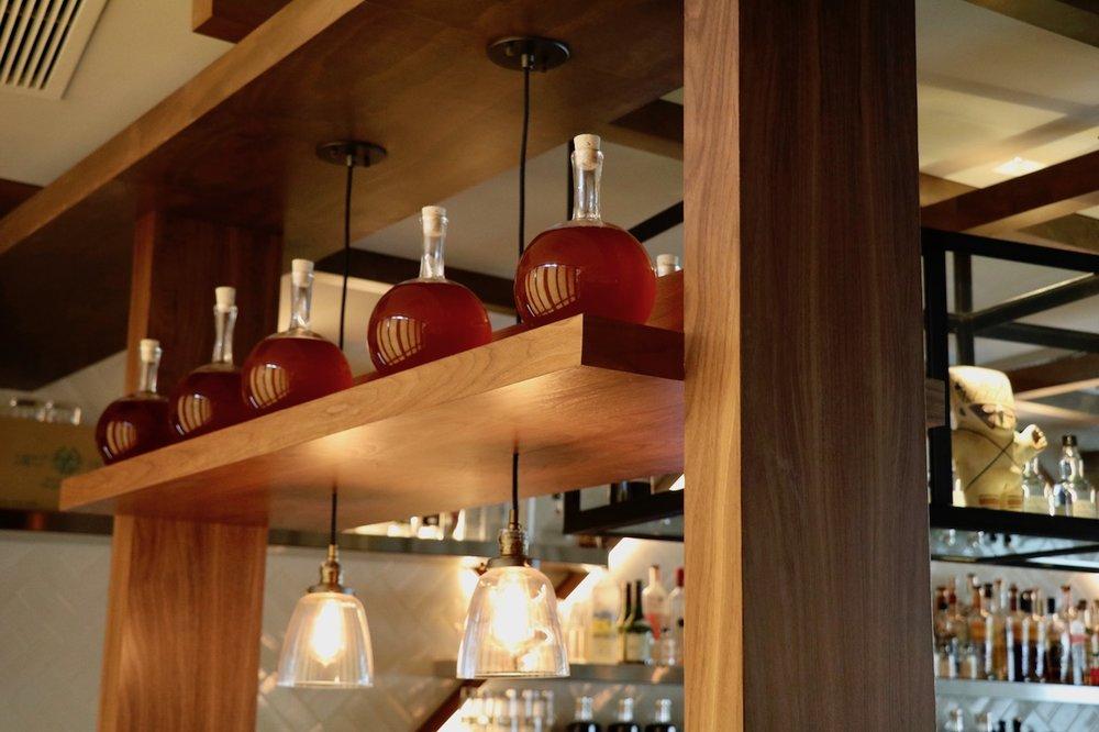 wood decor red bottles