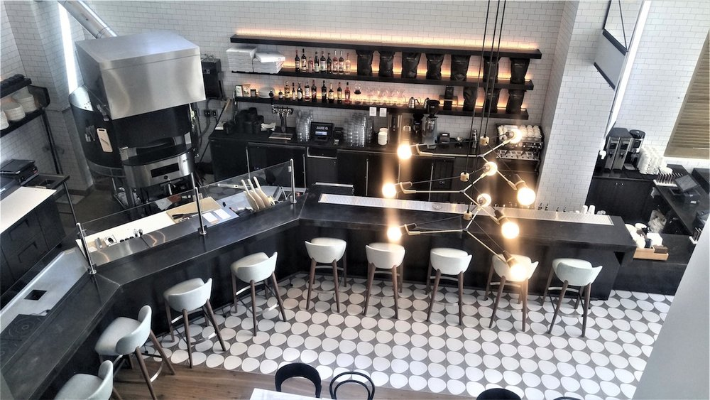 black and white cement tile open kitchen