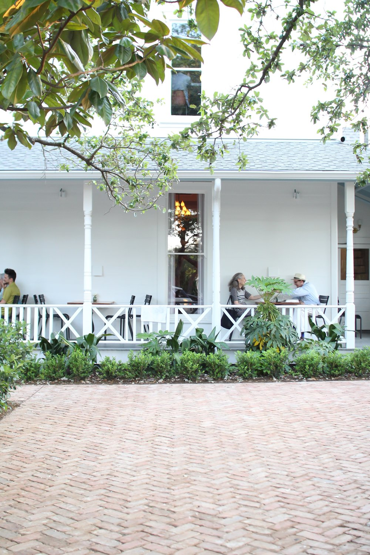 white porch historic farmhouse