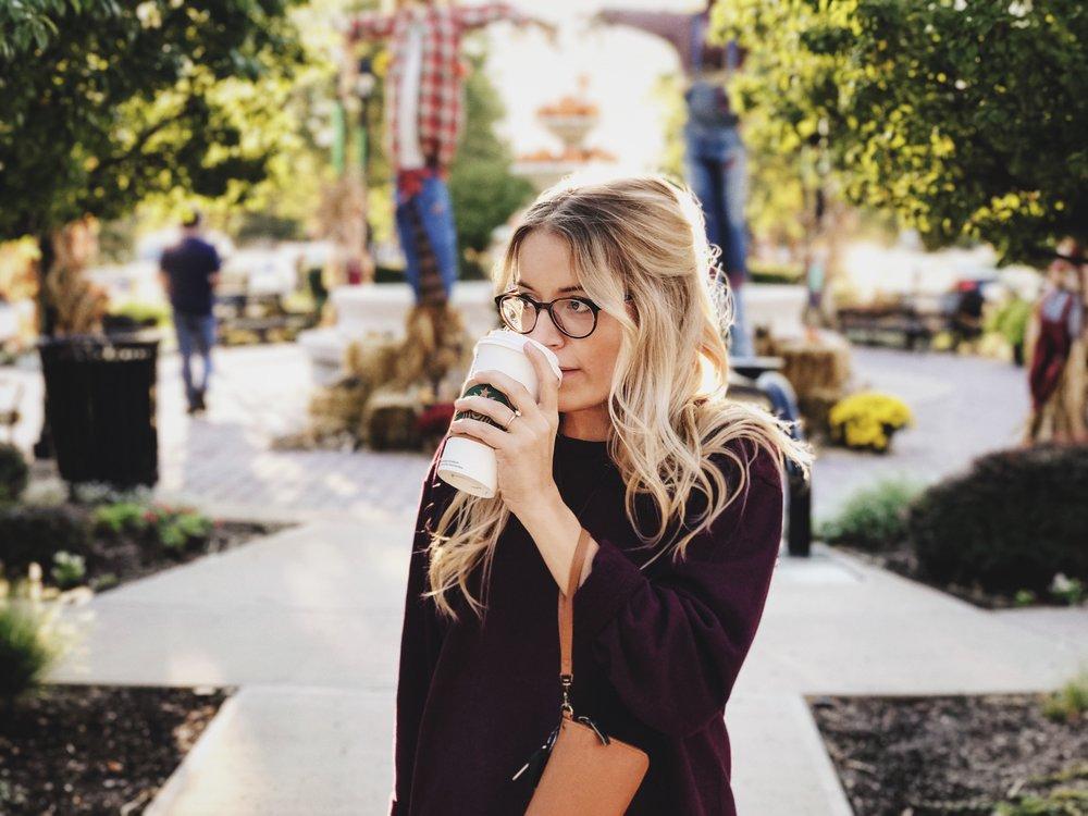 blonde girl wearing glasses  starbucks  drink
