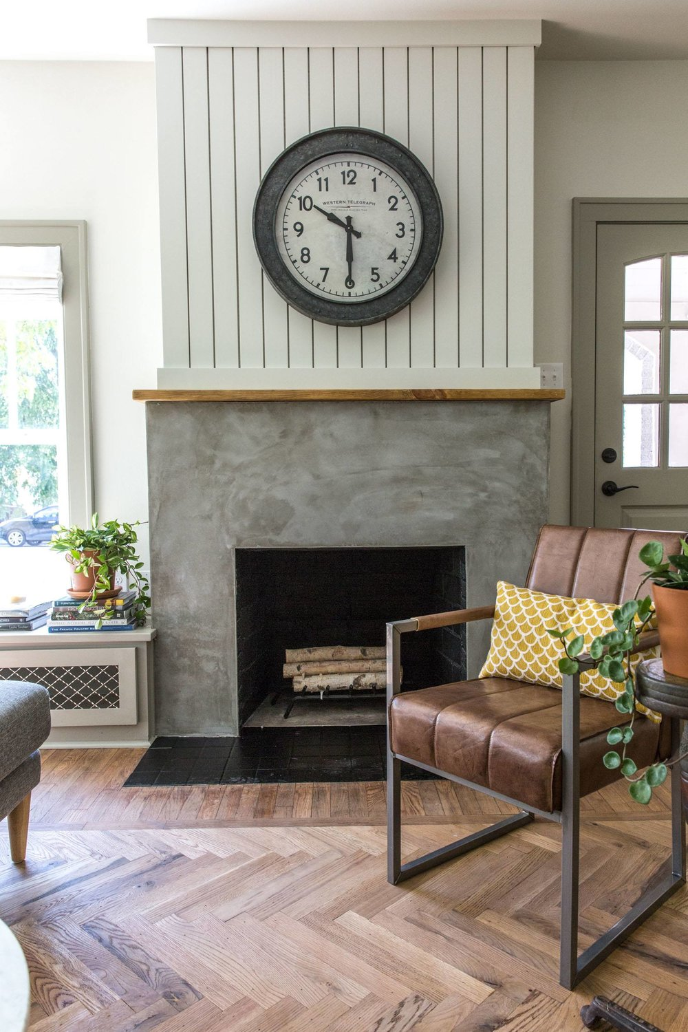 herringbone-flooring-concrete-fireplace-shiplap