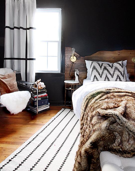 moody-bedroom-black-walls-wood-bedframe