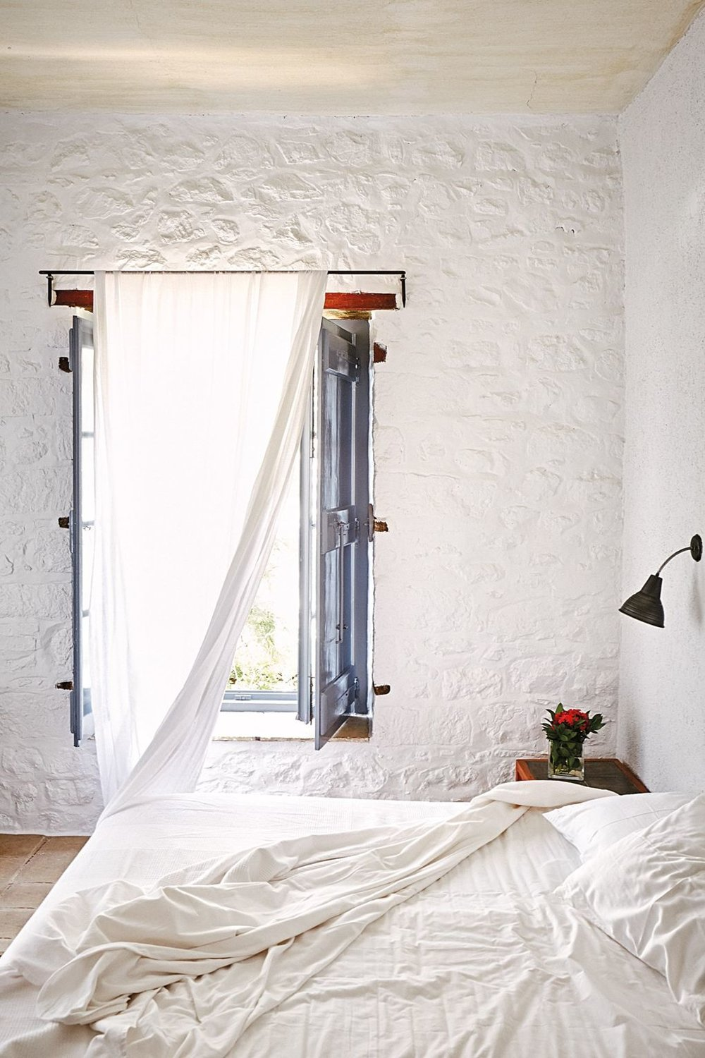 hotel-bedroom-greece-unmade-white-bed.