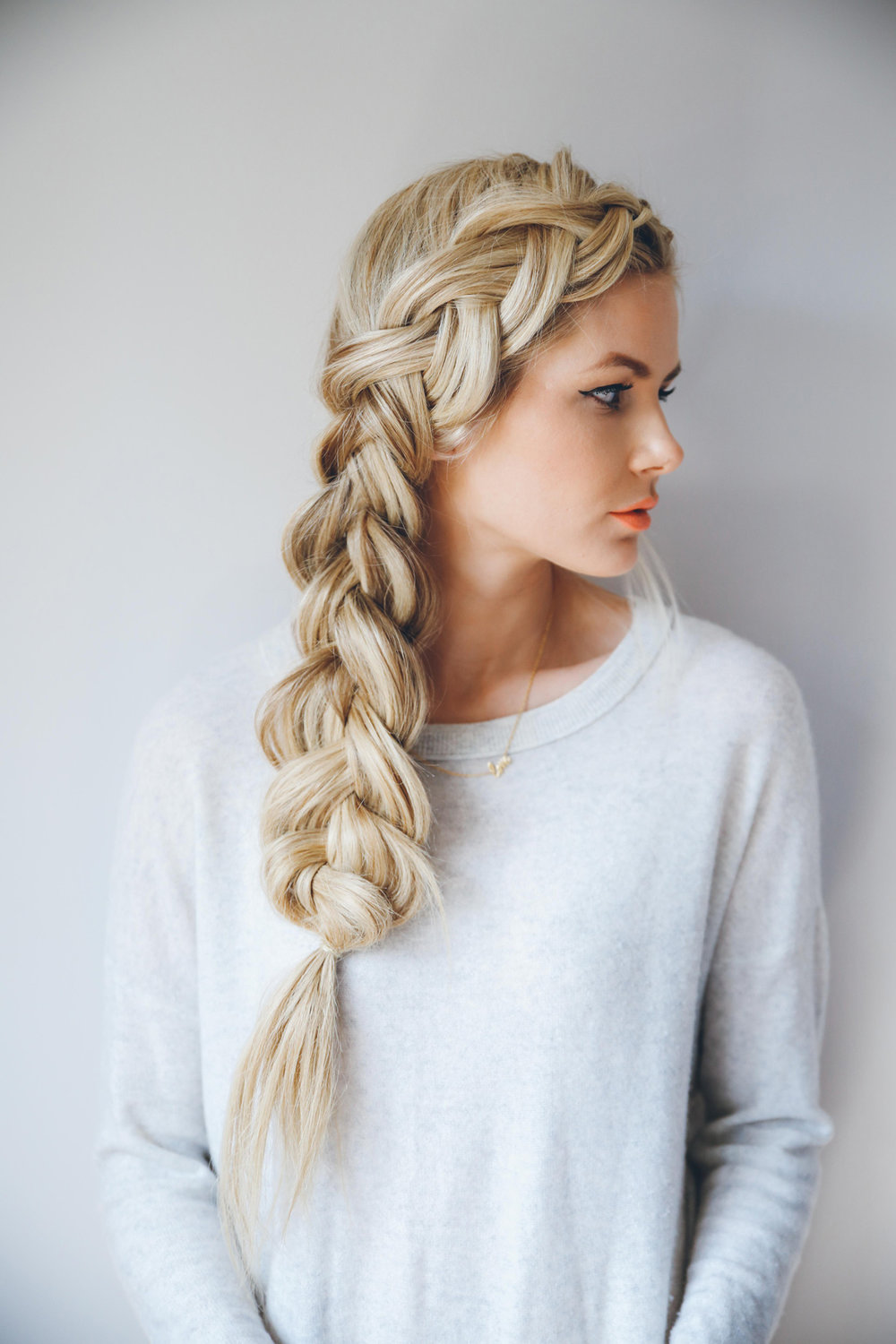 Full Side French Braid - This braid looks a lot more complicated than it is. Brush all your hair to one side, and start with a 2 inch portion at your bangs. As you work your way down, be sure to pull hair from behind and from the other side, braiding your way down. After tying the bottom, carefully pull hair from the inside of the braid, slowly working your way down. Don't be shy with this part as it is what gives this braid that voluminous look!