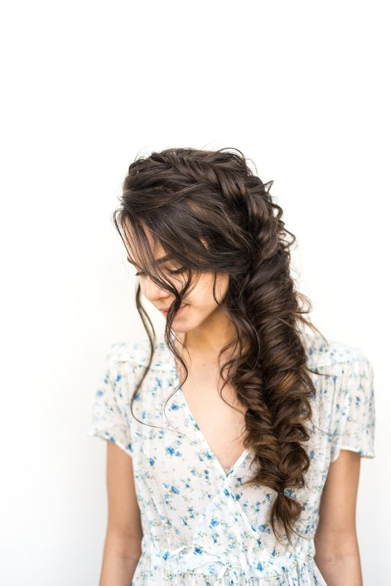 Full Side Fishtail Braid - This look takes a lot of hair, and extensions are welcomed! Part your hair down the side and start with the fishtail at the top of the part, toward the middle of your head (leaving the front hairs loose around your face). Continue to pull hair into the fishtail from both sides, all the way to the bottom. Secure with an elastic, and pull the fishtail loose carefully. Don't be afraid to mess up, as the messier the better with this look.