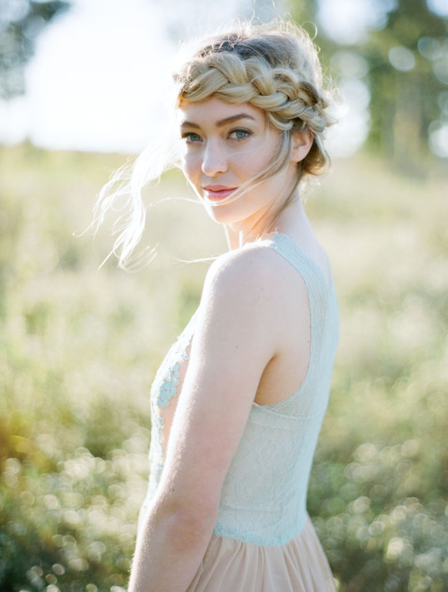 Halo Braid - This sweet style is perfect for a casual wedding (whether you are the bride or a guest). Part the hair down the middle all the way down to the nape of your neck. Start a French braid from the back and pull it around the left side of your head. Secure it in place so it dosn't come undone. On the other side, start another French braid around the front this time, pulling it the same direction (left) as the one before, overlaping them as needed. Pin into place, pull pieces out to loosen it, and set it with hairspray.