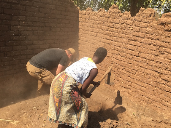 1. Chrigu and Monica breaking ground, small.jpg