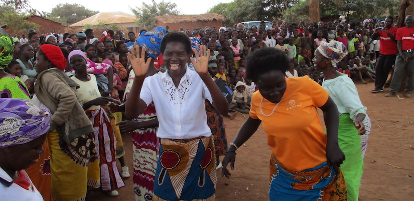 Eneres and mothers dancing at Mwanamanga Village