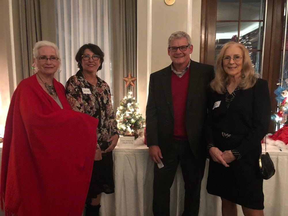 Peggie Roder, Sandra Summers, and Anna Haller pictured with the purchaser of the LCGMA Christmas tree entry.