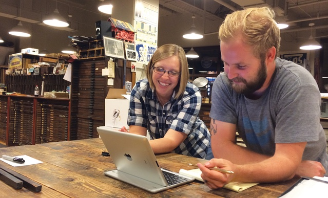 Erin and Andrew planning interview questions at Hatch Show Print