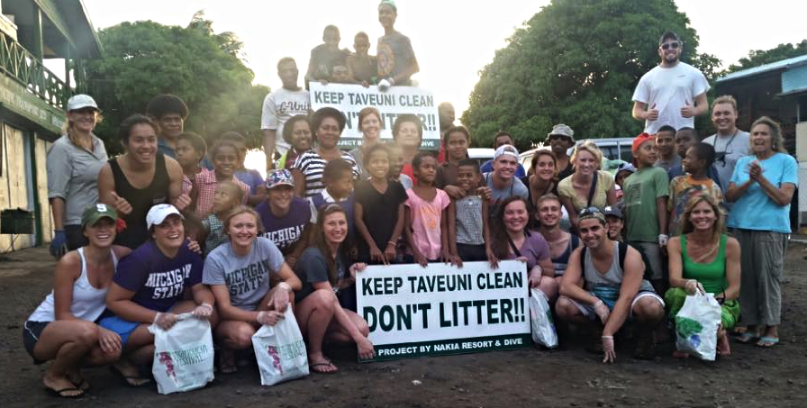The Spartans once more, this time pictured with Julie Kelly, bottom right in green, Robin Kelly, far right in blue, the driving force behind Keep Taveuni Clean, and the locals and tourists that helped with the cleanup that day.