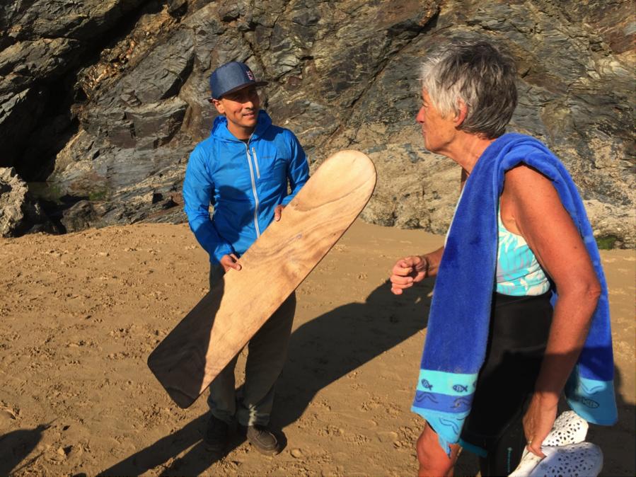 RAMON NAVARRO AND I MARVEL AT THIS PRE-PLASTIC SURFBOARD.