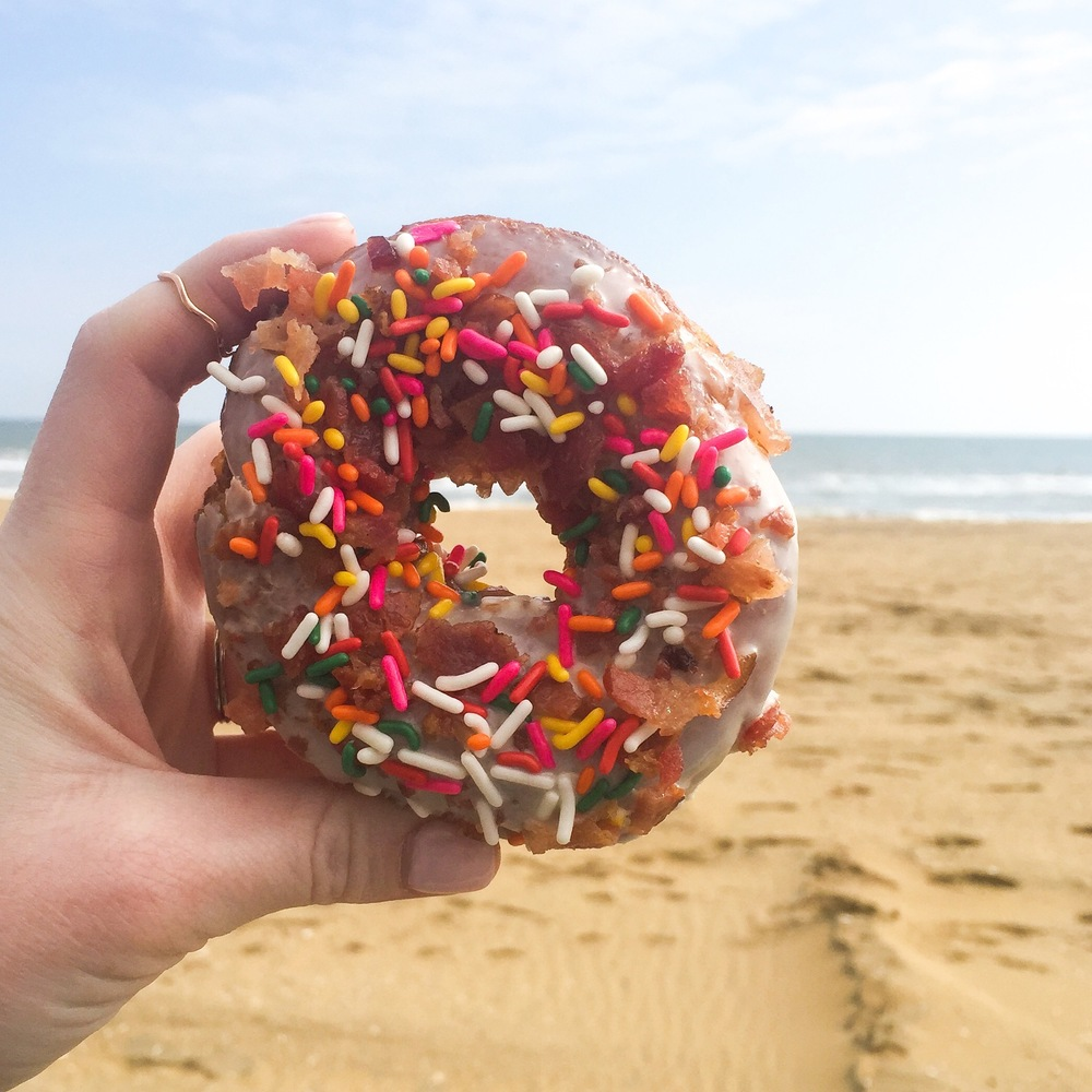 The perfect post-wedding breakfast - Maple glazed donut topped with bacon AND sprinkles from Duck Donuts