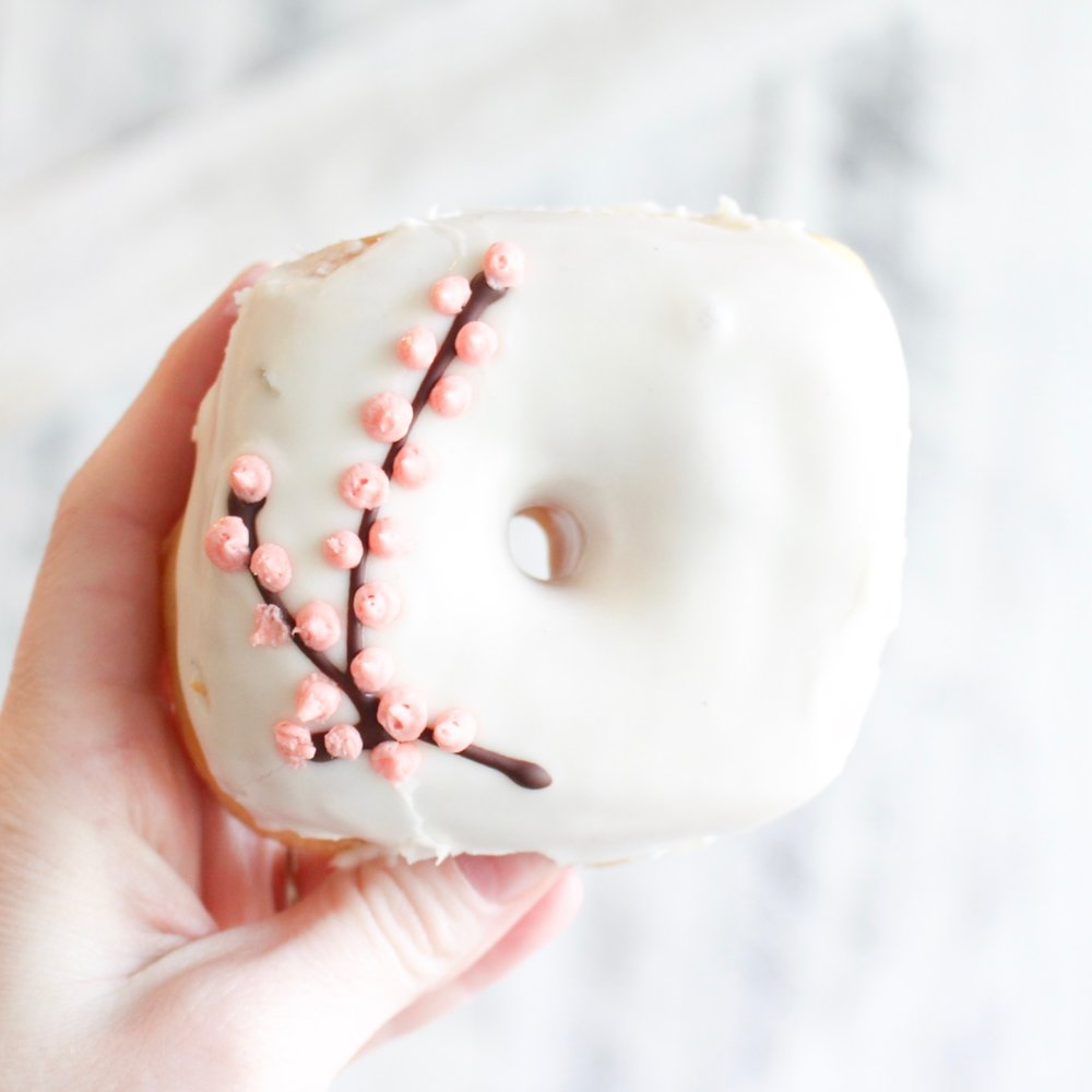 Cherry blossom season is here and D.C. is baking on theme. How beautiful is this donut from Astros?