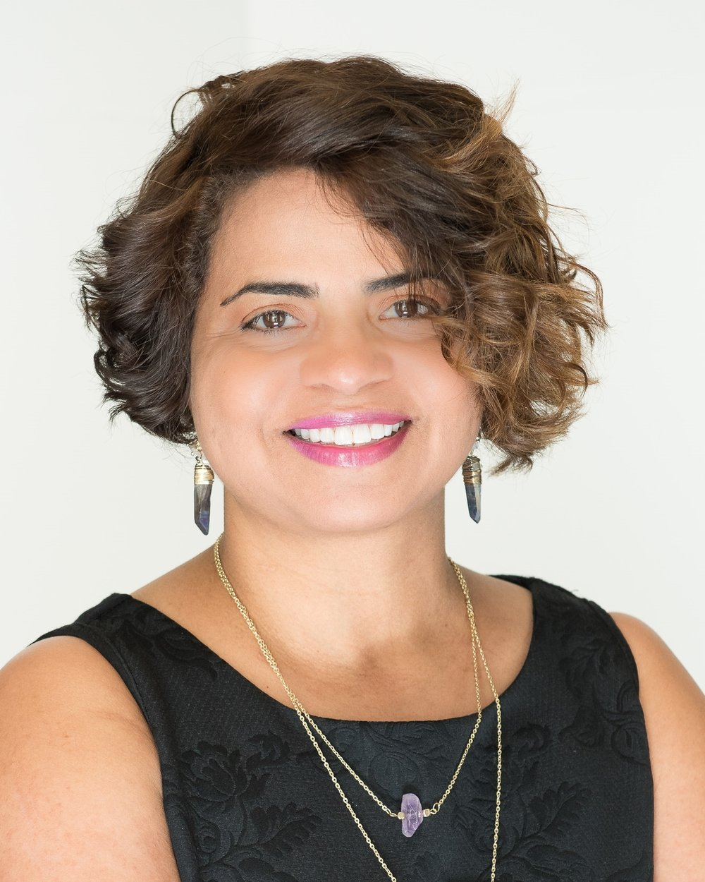 Delilah Santiago <i>Associate Vice President of Programs</i>