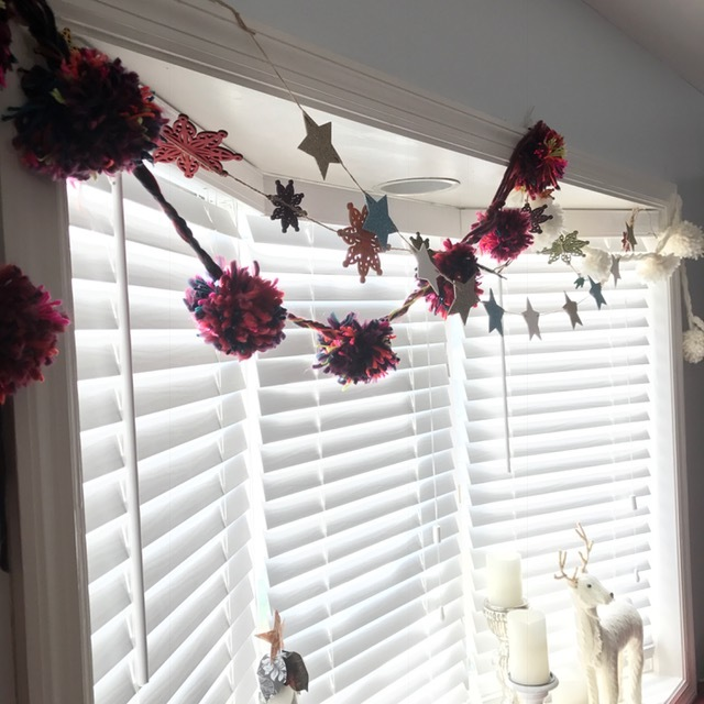 Inspired by Anthropologie's snowball pom pom garland, I made my own in this crazy maroon mix and winter white.