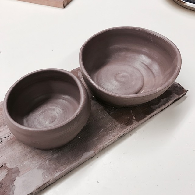 These are the first 2 vessels I made in ceramics class!! They are still wet and raw in this picture. I will be posting many more pottery pictures as I progress. I am hooked and can't wait to learn more...