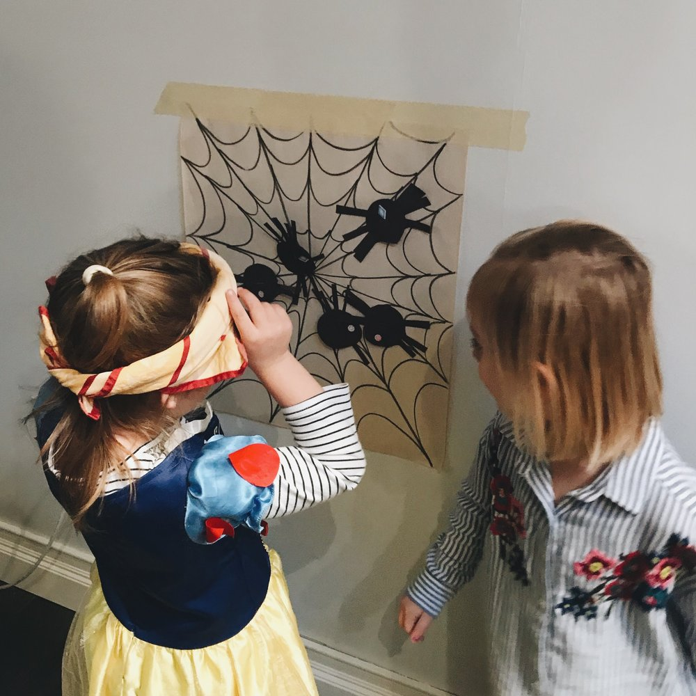 "Chi Chi and I drew out a web to tape up to the wall and cut out some spiders for ""Pin Charlotte on the Web"" which was a major hit! They didn't care who won, they were cheering each other on, and they kept pulling the spiders off to try over and over. It was perfect to occupy them while the grown-ups cleaned up."