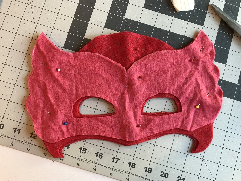 Pin pink layer to quilted layer & sew