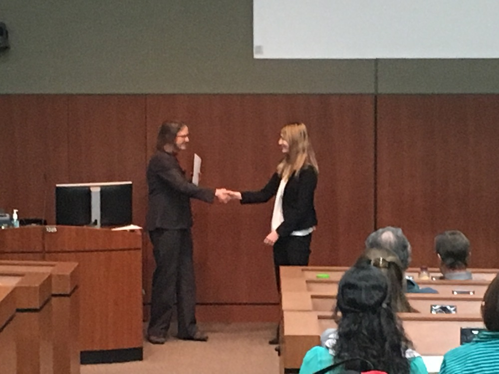 Ann congratulating the winner of the poster session, Tisha King-Heiden.