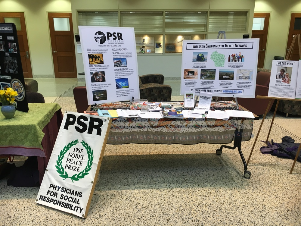 The WEHN and PSR table at the conference.