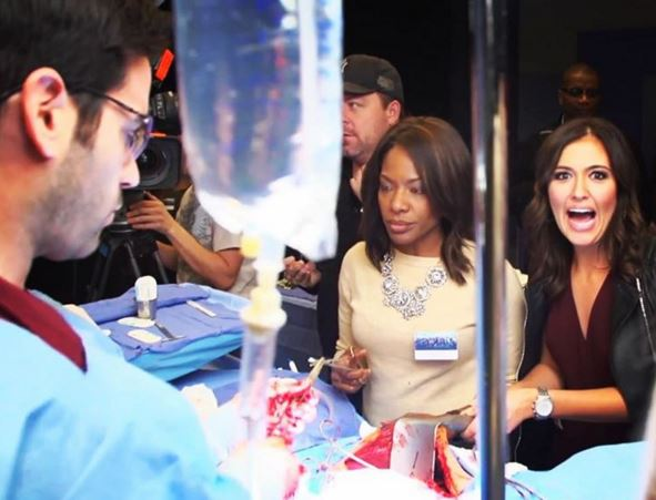 Actor Colin Donnell (L) showing me the ropes on how to do a procedure.