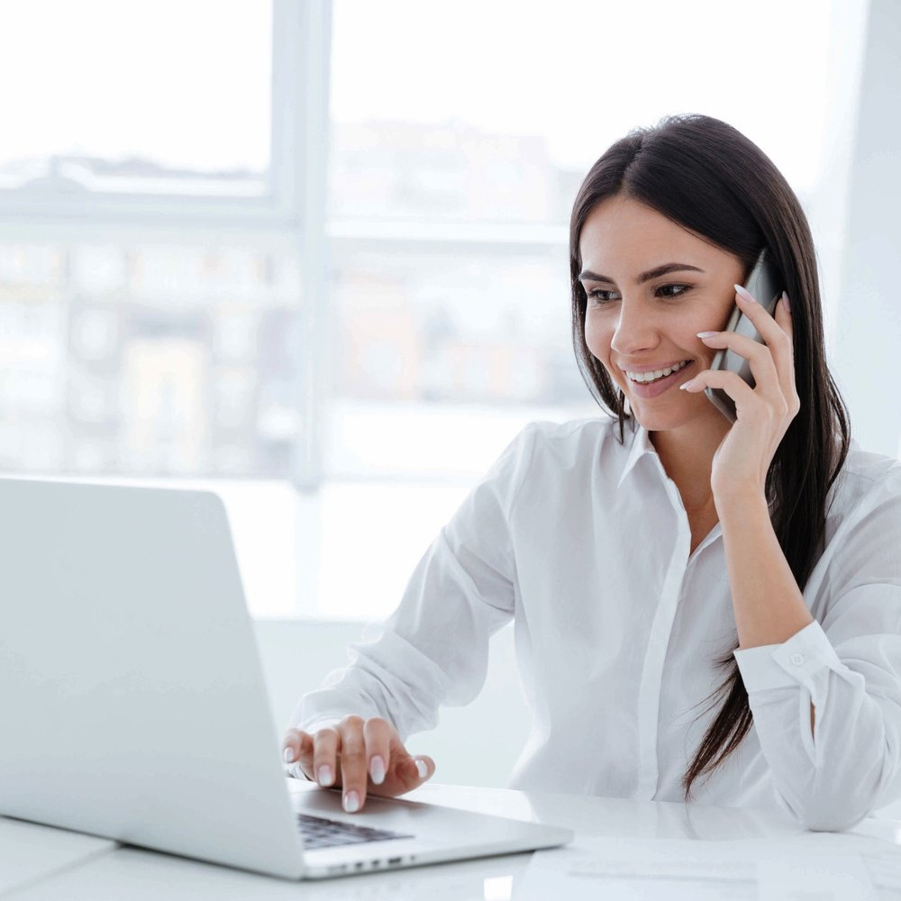 AdobeStock_131186932 woman on phone laptop (website).jpeg