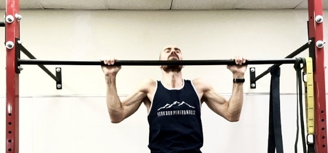Pull your body all the way up until you can lift your chin above the bar.
