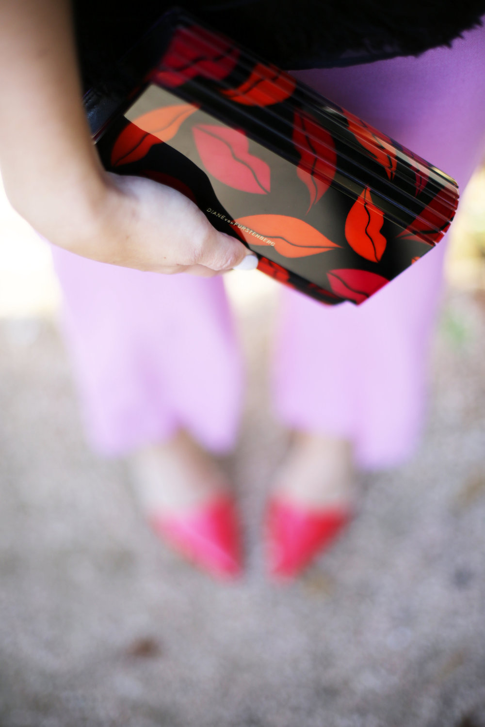 J.Crew Pink pants, hunter bell fringe top, red shiny ponies and DVF lip clutch. Valentine's Day Fashion 3.jpg