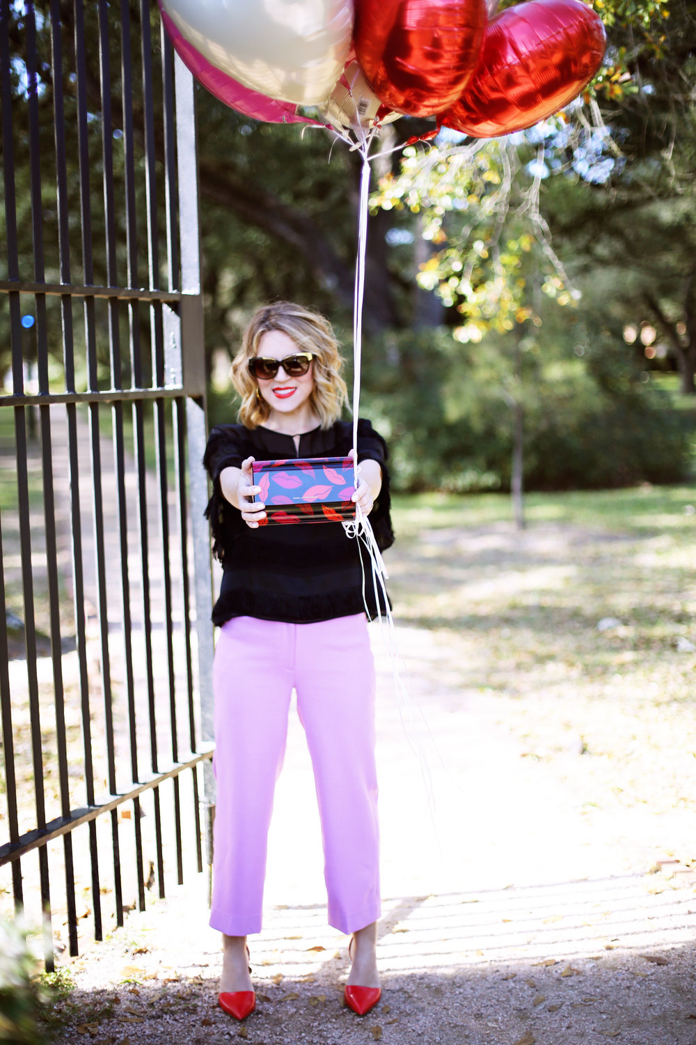 J.Crew Pink pants, hunter bell fringe top, red shiny ponies and DVF lip clutch. Valentine's Day Fashion 5.jpg
